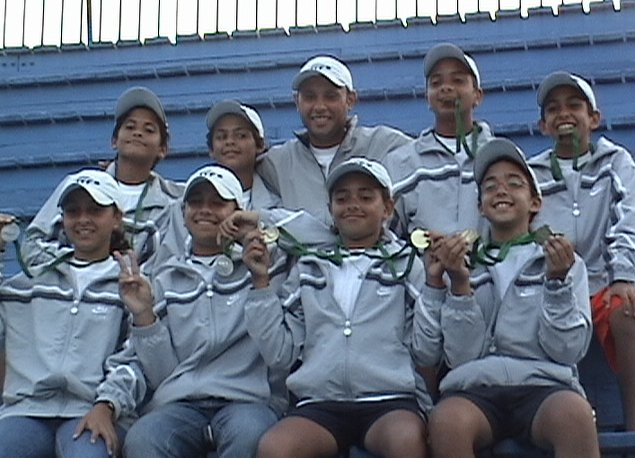 Egyptian Team in the Ceremony of The ITF/CAT 13 & under Circuit 2006 with Coach Mohamed Ramadan